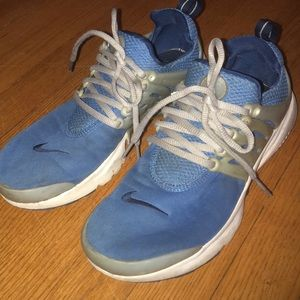 Nike sneakers, blue mesh, gray sides.